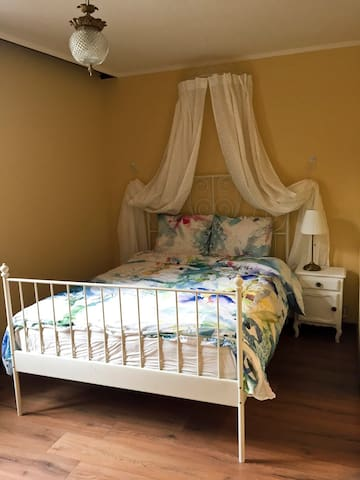 A double bed (140x200cm) in bedroom