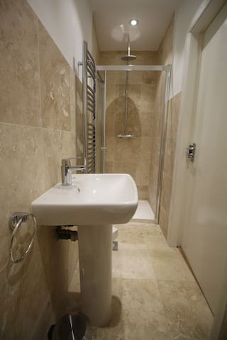 New, clean private bathroom with double shower