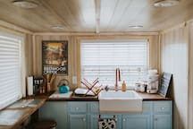 the perfect size kitchen for a getaway - microwave -fridge -2 burner stove top -tea kettle -coffee pot (sugar& cream)  -sink -all utensils + tools -spice rack