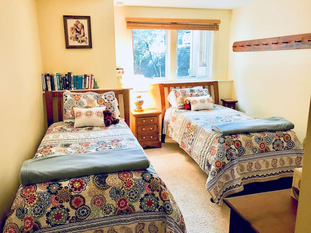 Twin BR is decorated in shaker style with quality mattresses
