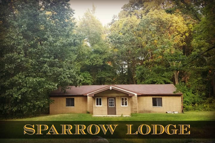 Sunset Place lodge in the woods (Sparrow)