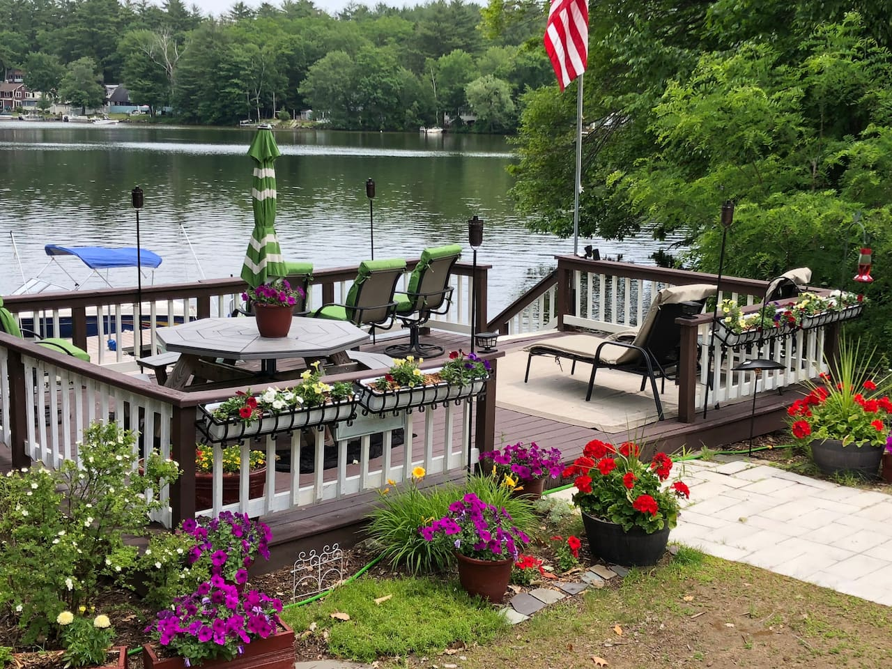 Lakeside deck and dock for your use with 8 seat picnic table chairs and optional boat mooring. (Dock and mooring are seasonal) We occassionally access the dock to use our boat, but other than that you have it to yourselves, along with the pedal boat.