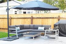 Sunny outdoor seating area with bbq. This is a shared space.