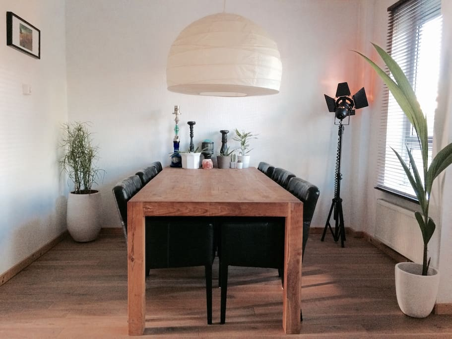 Oak wooden table with 6 leather chairs