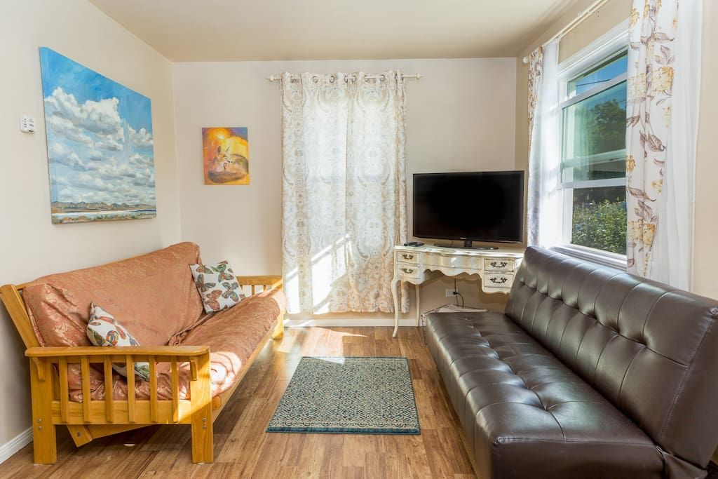 Relax in our cozy, bright living room, and read a book or watch Netflix on the flat screen TV.