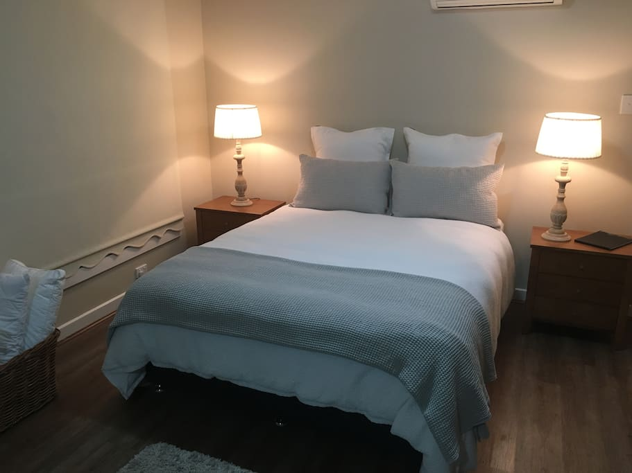 New queen bed. All linen supplied by Adairs. Lamps by Laura Ashley