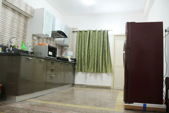 Fully equiped Modular kitchen with all amenities. Four stove burner with an exhaust hood for comfortable cooking. A  Large conventional microwave, Toaster and utensils for comfortable cooking.