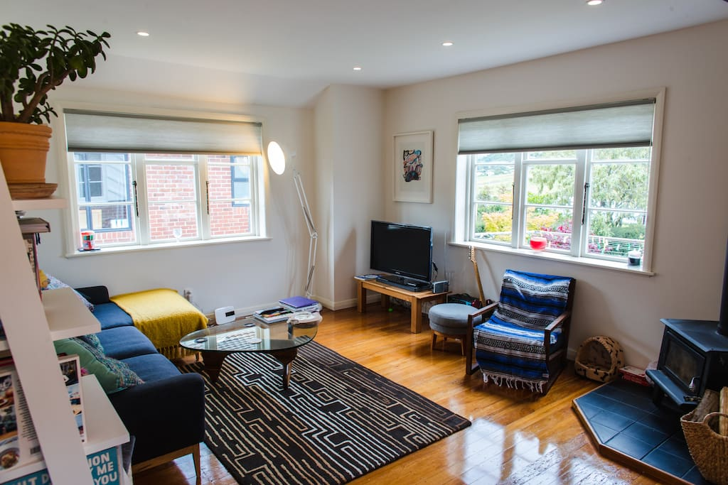 Polished wooden floors, lots of space on the couch and fire place in the corner