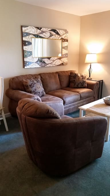 Comfy sofa with memory foam pullout bed.