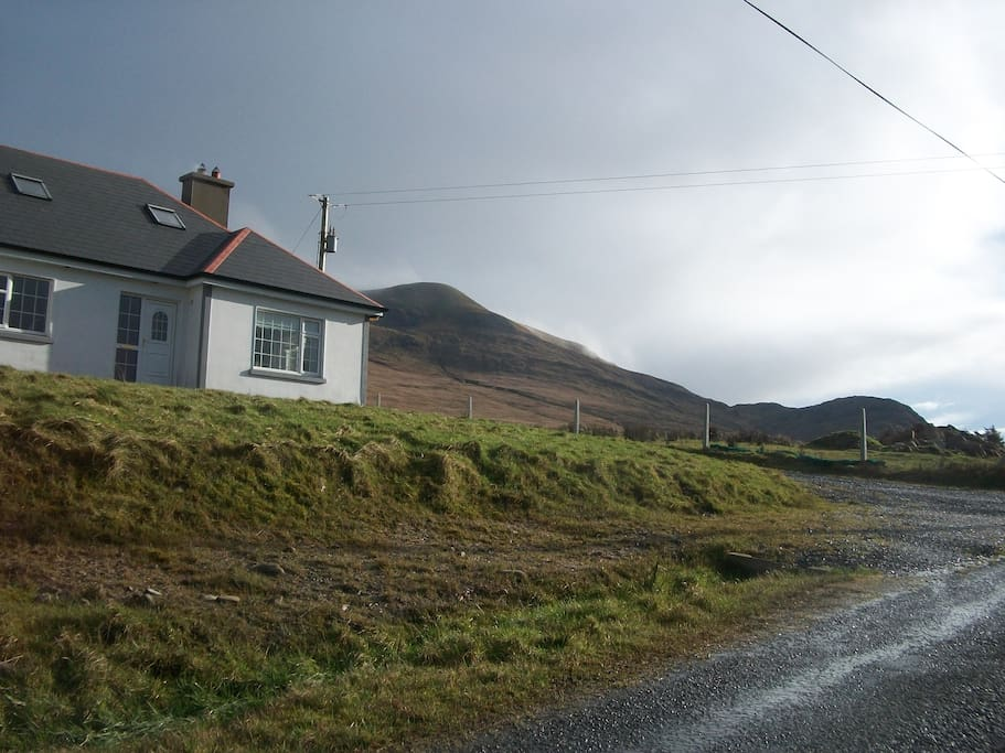 House from road showing Mweelrea mountain, (popular with climbers).