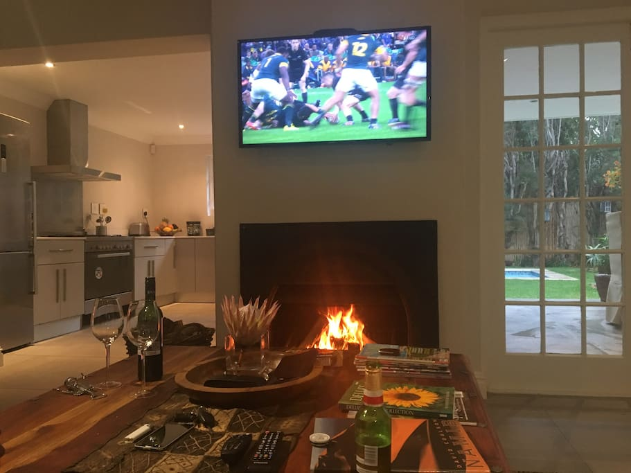 Cosy lounge with fireplace, DSTV and Free WIFI