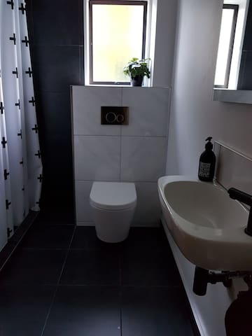Recently renovated bathroom with underfloor heating and fully tiled shower.