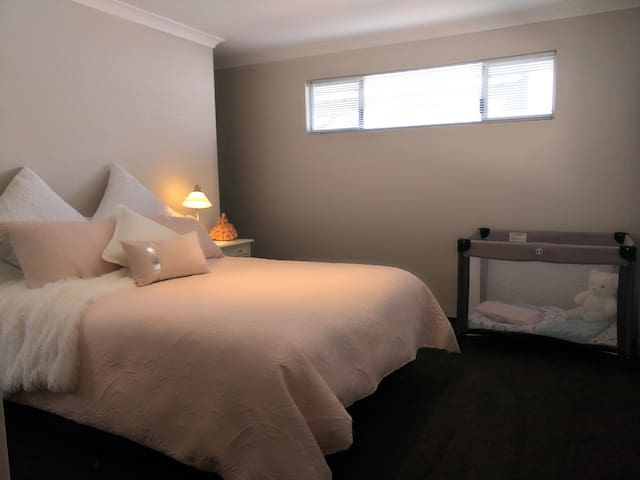 Main bedroom, ensuite and baby Cot.