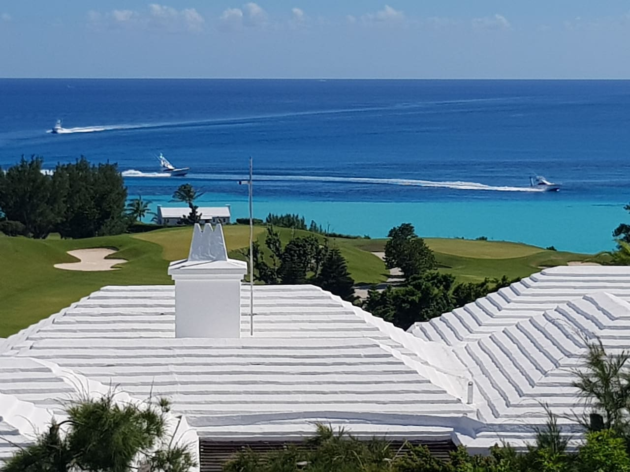 This is our view...EVERYDAY!  True color of the ocean.  Boats returning from a fishing tournament.  Port Royal Golf Course views from 'Pompano Flats Ocean View 'Studio Suite.
