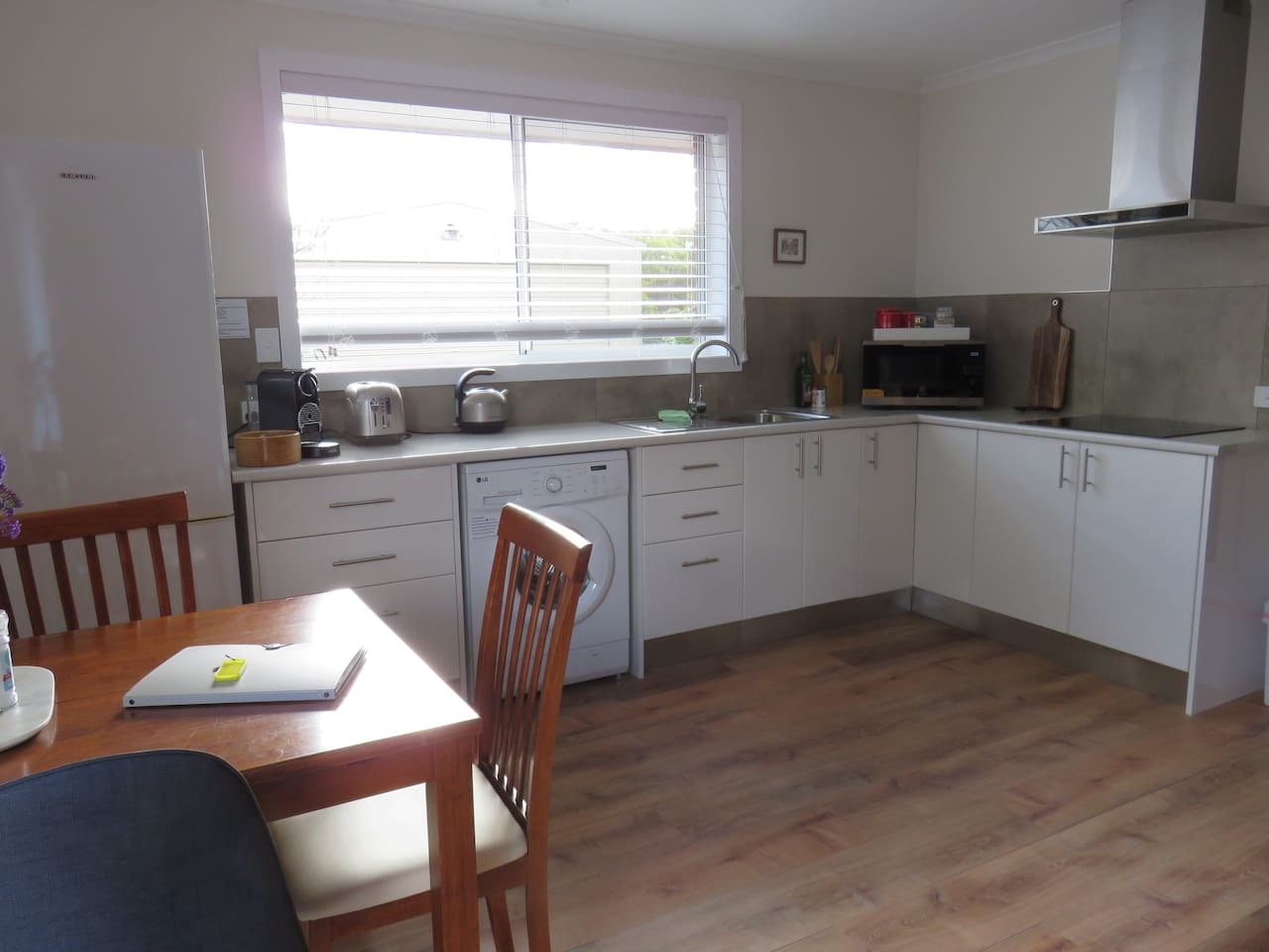 Fully equipped kitchen with full size fridge/freezer and electric cook top. Coffee machine with milk frother, and a range of breakfast options.