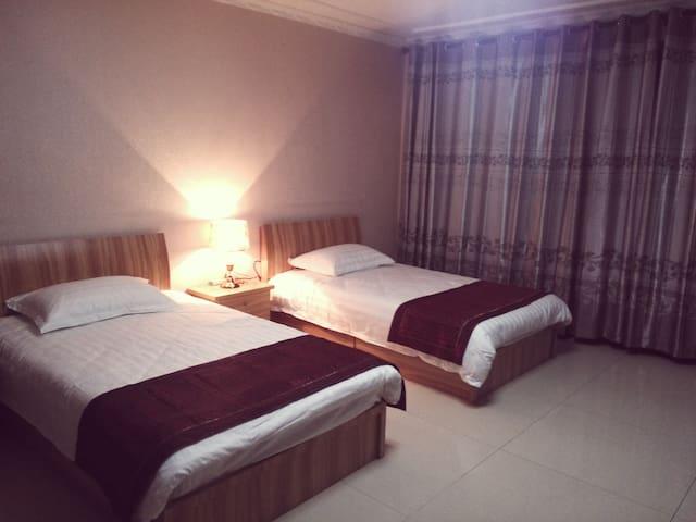 舒馨公寓位于市中心莫家街黄金地段,购物便利! - Xining - อพาร์ทเมนท์