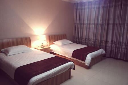 舒馨公寓位于市中心莫家街黄金地段,购物便利! - Xining