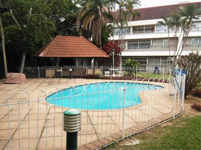 Fenced swimming area with braai facility.