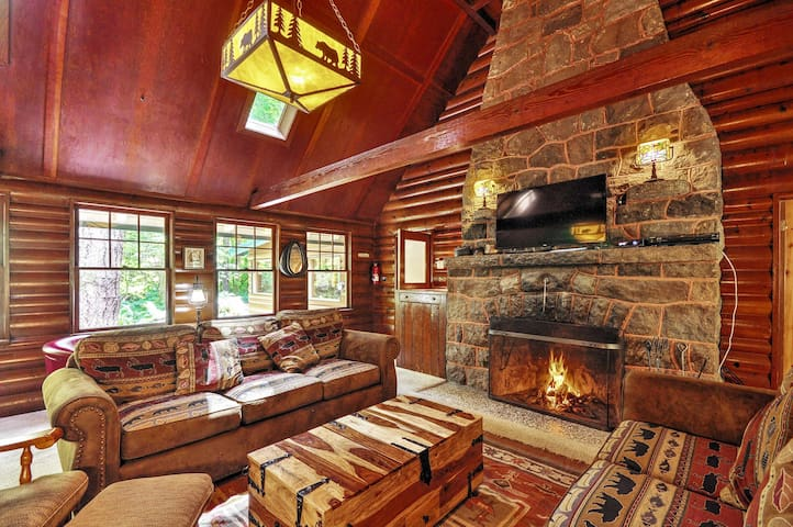 Step into this luxurious log cabin and cozy up by the wood-burning fireplace
