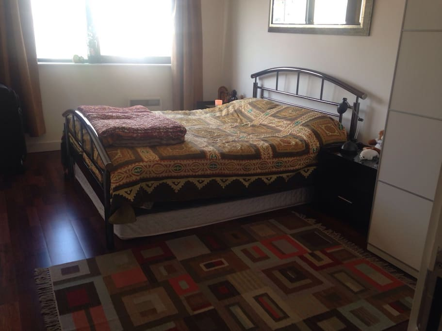 Large double bedroom with en suite bathroom. Lots of light during the day