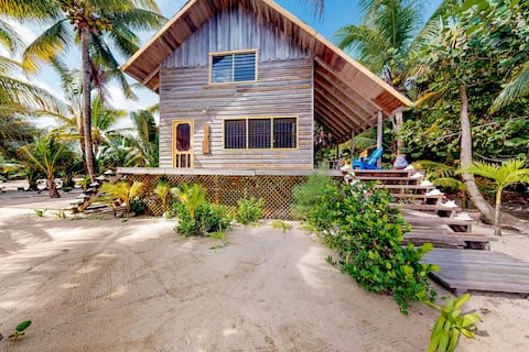 Romantic beachfront home w/ dock, hammock, veranda & outdoor dining!