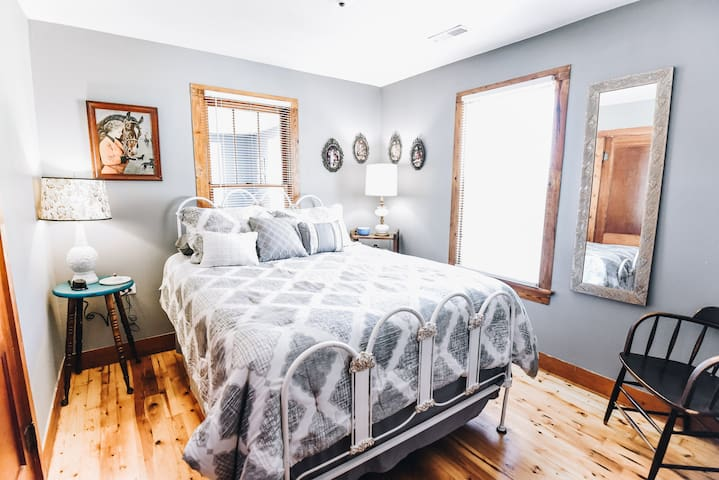 Bedroom two with Queen size antique iron bed and one power charging station.