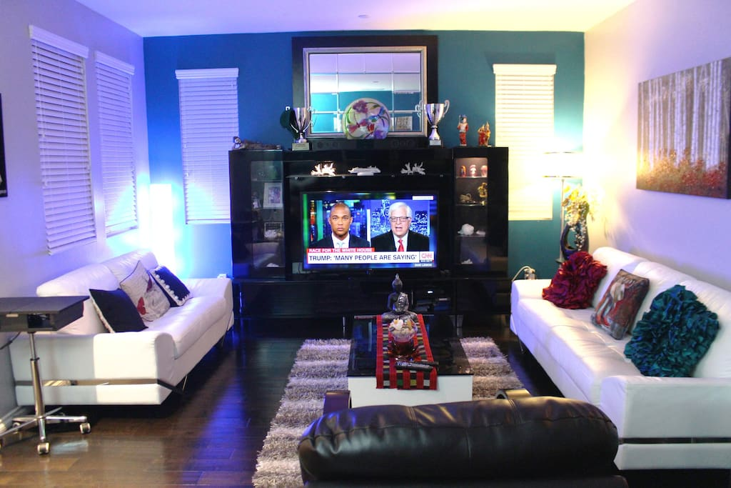 Spacious living room with modern TV and furniture