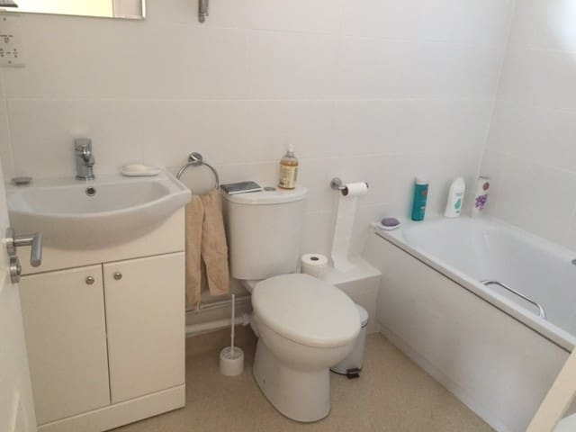 En-suite bathroom, newly tiled and decorated. Over bath shower.