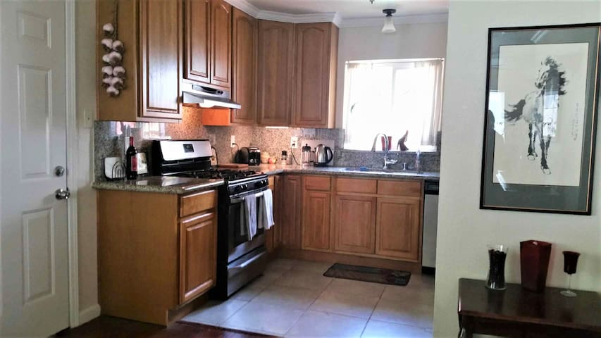 Kitchen has a gas stove and dishwasher.