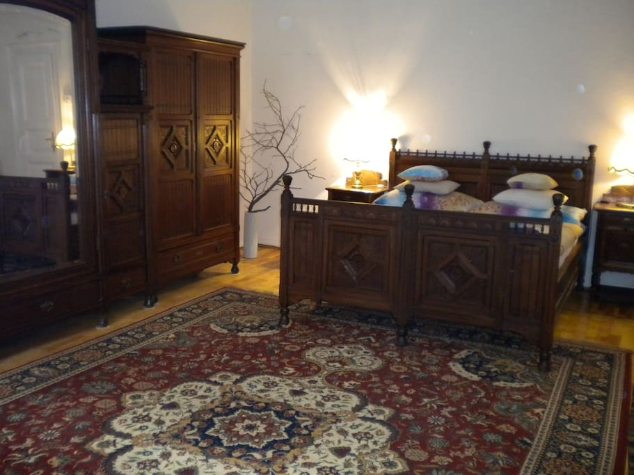 Old royal double bed in the bedroom