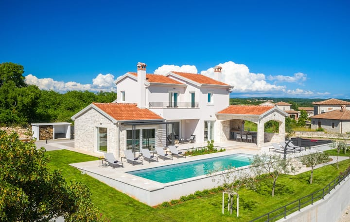 Stunning home in Sveti Lovrec with Outdoor swimming pool and 4 Bedrooms