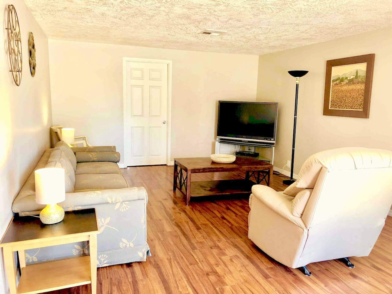 """Living room.  55"""" HDTV has Amazon Fire TV Stick, with AT&T TV streaming video service, Prime Video, HBO GO, ESPN+ and more!"""