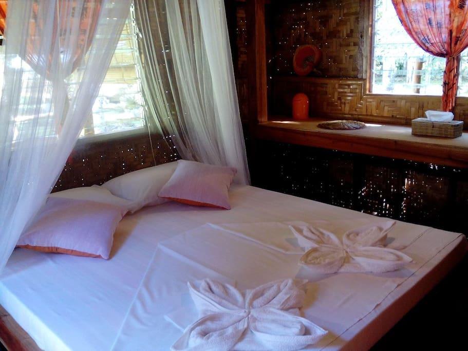 Bedroom of Orange bungalow with queen size bed