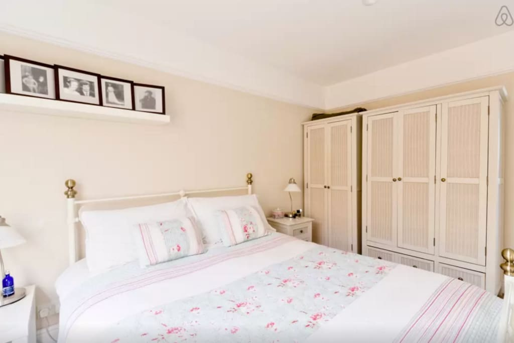 Huge kingsize bed, new mattress and bedding makes for a very comfy sleep. Ample storage.
