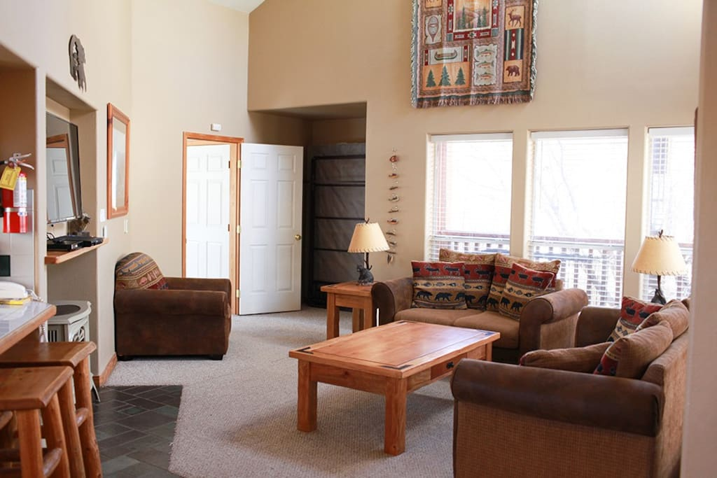 The vaulted ceilings, natural light, gas fireplace and flat screen TV make this an ideal living room to relax. The living room also has a Murphy bed and sofa sleeper.