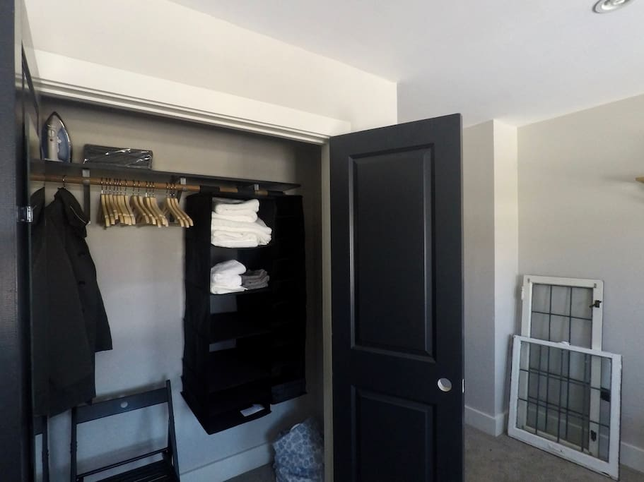 You'll find a lot in the spacious closet: extra chair, iron, hangers, laundry hamper, shelf space, clean towels & wash cloths.