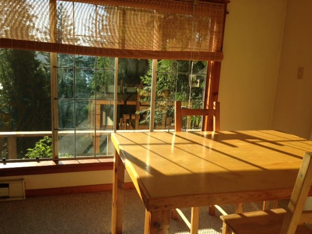 Nice table in sunroom for art, work, or eating