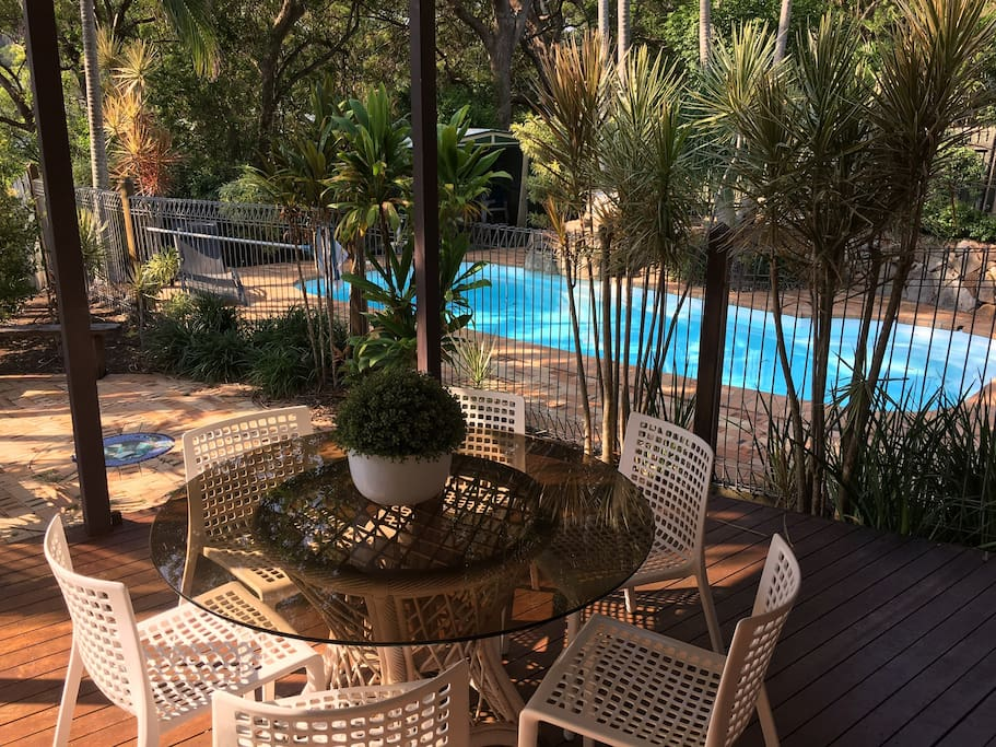 Relax on the private deck area overlooking the inground saltwater pool