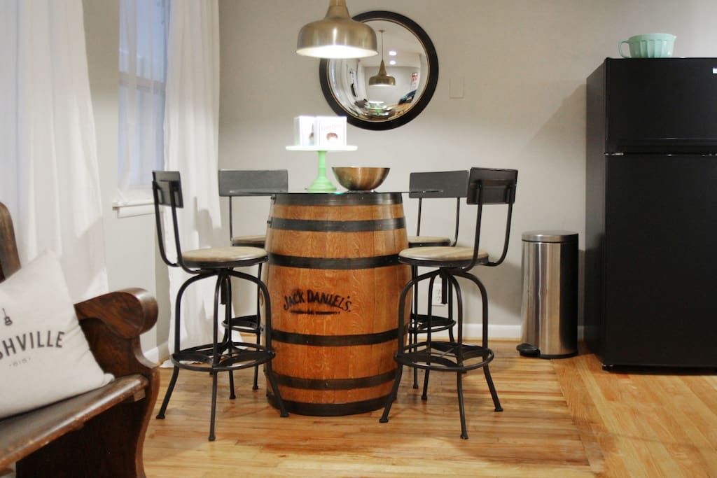 Jack Daniels barrel that was a gift to me that my husband made into a high top table.