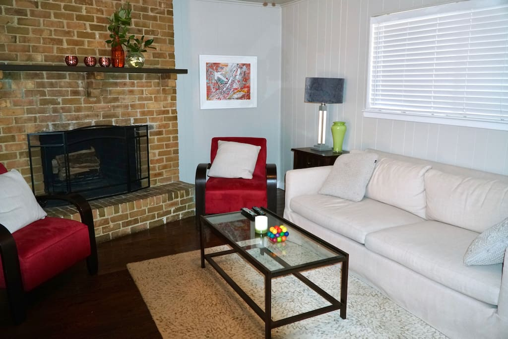 """Cozy spacious living room, with a nice fireplace and a 65"""" TV!"""