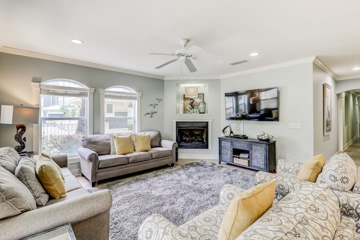 Coastal chic condo steps from the sand w/ shared pool & central location!