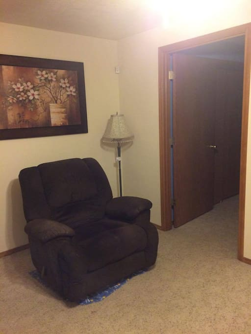 Recliner in living room area; bedroom entrance.