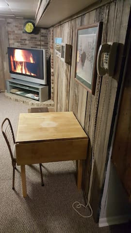 Dining Table with Chair and Phone for Making Local Calls