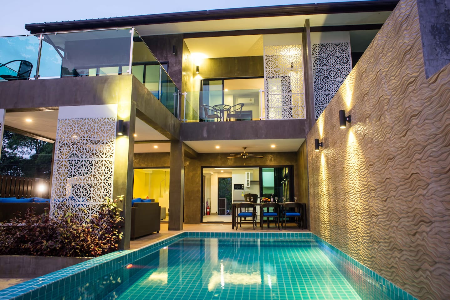 A stylish modern villa with a private pool, large garden and outdoor living space