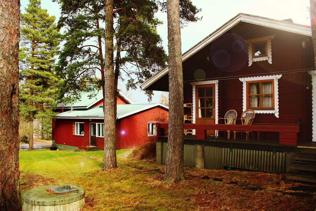The Sauna Hut on the front, the Main House in the back. Viewed from the backyard.