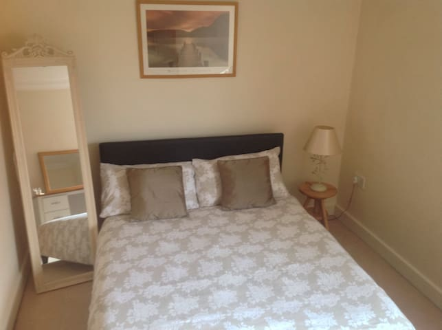 Spacious double bedroom at the rear of the apartment in a quiet location