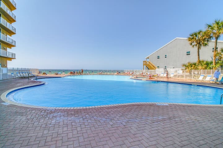 Gorgeous and homey beachfront condo with shared pool, beach access, & free WiFi!