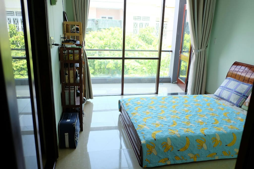 The private room where you will sleep, with street view, and the balcony