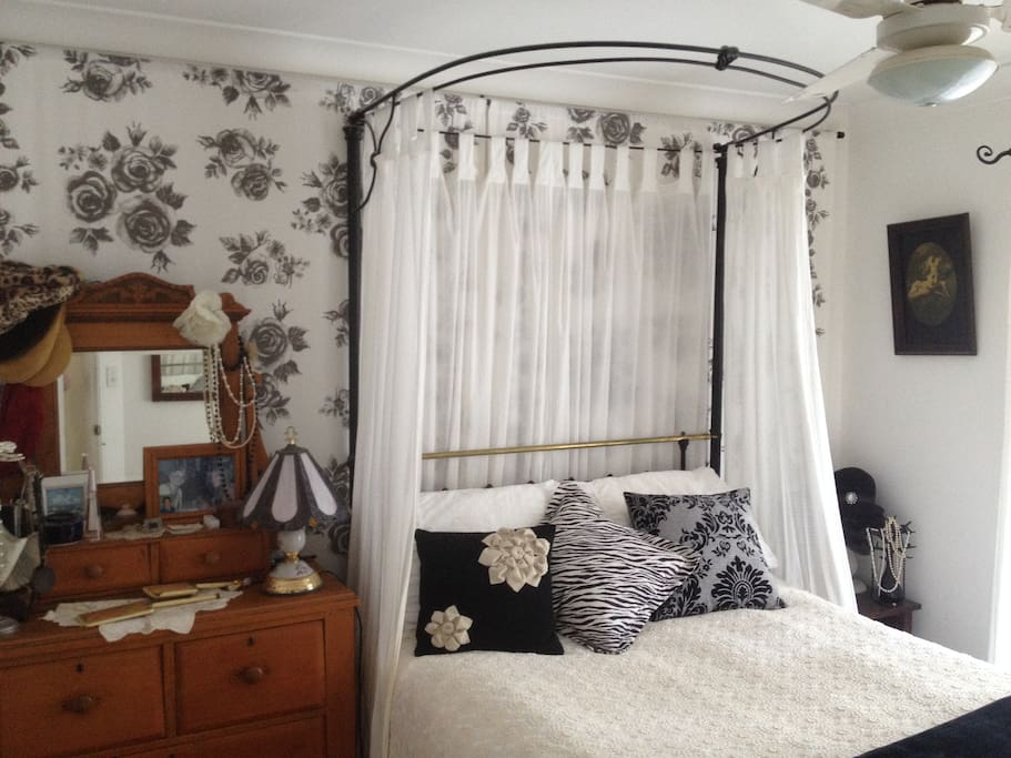 Romantic main bedroom featuring comfortable antique double bed
