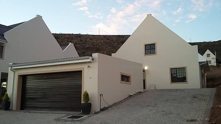 Casa Bonheur is an open-plan dwelling in a valley.